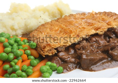 Steak pie with mashed potato and vegetables - stock photo