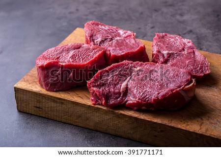 Steak. Raw beef steak. Fresh raw Sirloin beef steak sliced o Herb - Rosemary decoration. See the full set of 100 amazing photos - stock photo