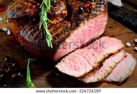 steak, rosemary and beer on a wooden background - stock photo