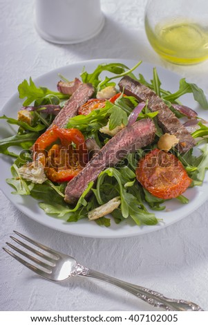 Steak Salad with Arugula, Tomatoes, and Croutons with Salt and Olive Oil