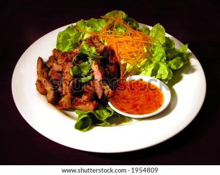 Steak salad with sweet chili sauce - stock photo