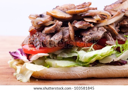 Steak Sandwich With Cheese Beef And Vegetables - stock photo