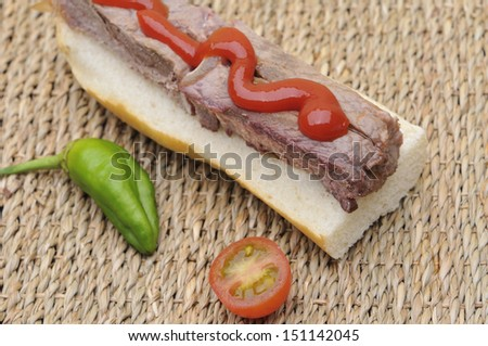 steak sandwich with pepper and tomato. Beef snack - stock photo