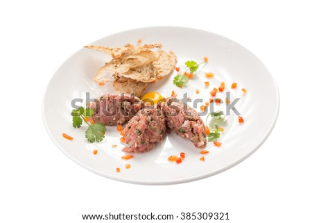 Steak Tartare with bread toasts isolated on white background