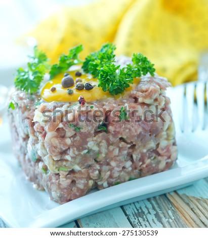 Steak tartare with yolk - stock photo