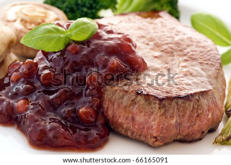 Steak with cowberry sauce - stock photo