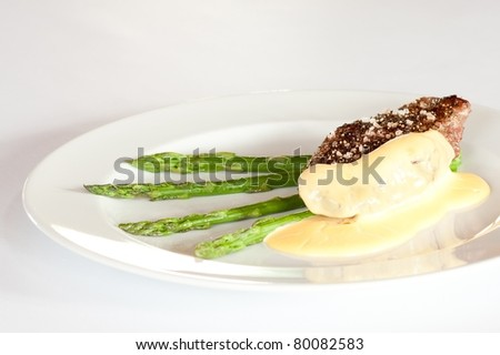 Steak with Dijon sauce and asparagus - stock photo