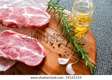 Steak with marinade ingredients - stock photo