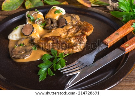 Steak with potato dumplings and forest mushroom sauce - stock photo