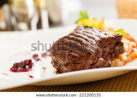 steak with potatoes - stock photo
