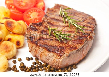 Steak with potatoes and tomatoes - stock photo