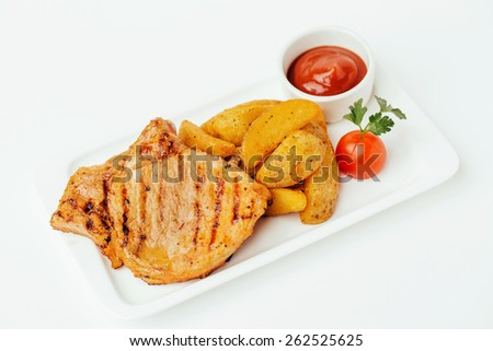 Steak with Tomato red Sauce and potatos - stock photo
