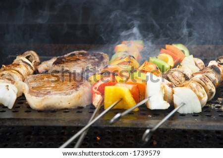 Steaks and vegetables on the grill - stock photo