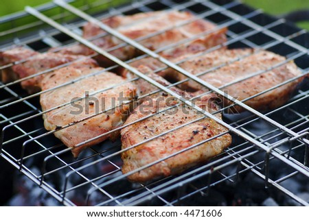 steaks grilled on a charcoal grill