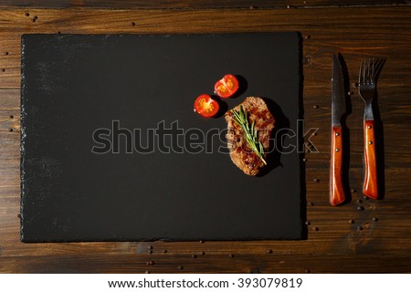 steaks on a dark background. Food border background, copy text space - stock photo