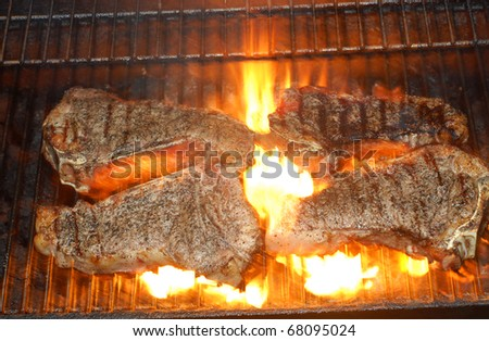 steaks on the grill - stock photo