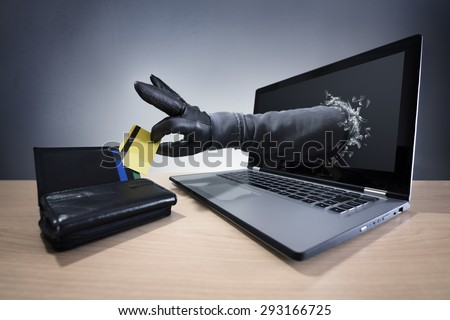 Stealing a credit card through a laptop concept for computer hacker, network security and electronic banking security - stock photo