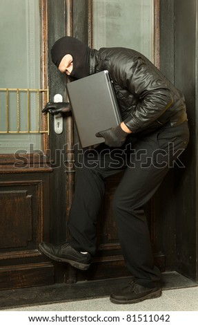 stealing a laptop - stock photo