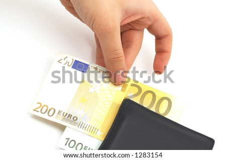 stealing from leather wallet - stock photo