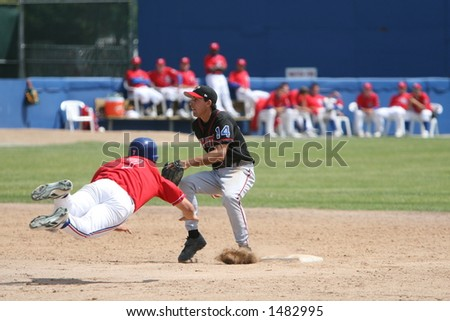 Stealing second base - stock photo