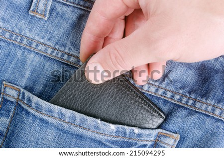 Stealing wallet from back pocket of jeans - stock photo
