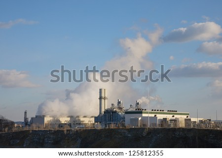 Steam and Exhaust let off from a Natural Gas power station - stock photo