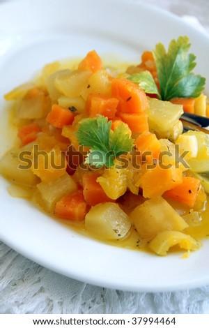 Steam autumn vegetables - pumpkin, carrot, squash, onion, sweet pepper - on a white plate - stock photo