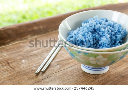 steam Blue Rice In Cup - stock photo
