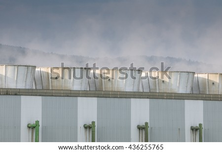 Steam coming from the chimneys of power plant. - stock photo