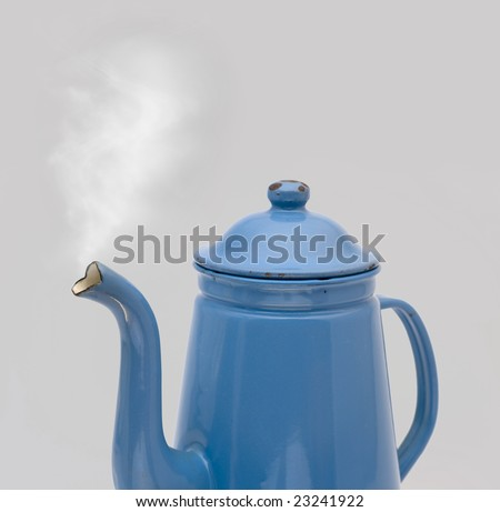Steam coming out of an old antique coffee can - Madam Blue - stock photo