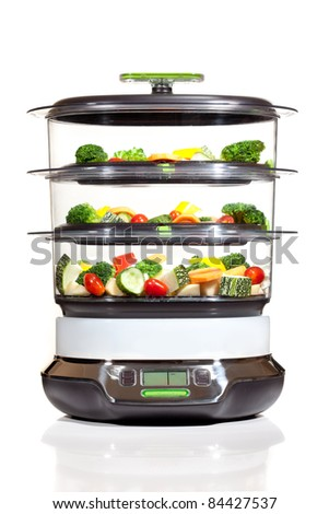 steam cooker with vegetables on a white background