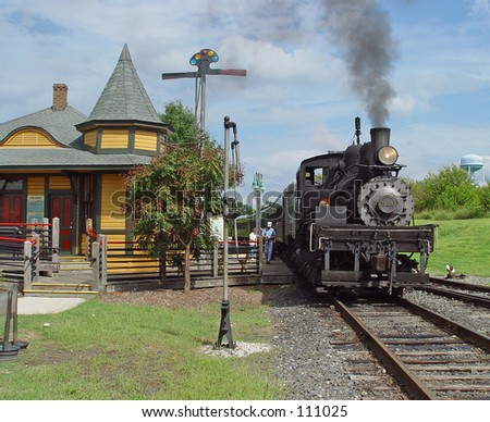 Steam engine and depot - stock photo