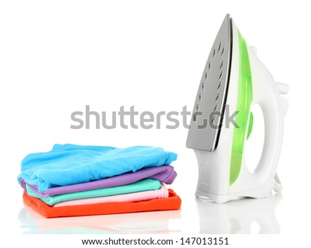 Steam iron and clothes, isolated on white - stock photo