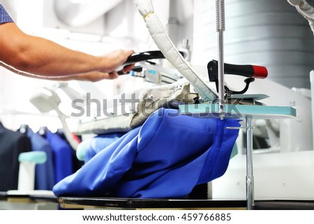 Steam iron.Presser in sewing clothes pressed.