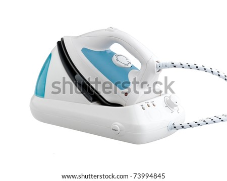 Steam iron with base the laundry machine tool isolated on white - stock photo