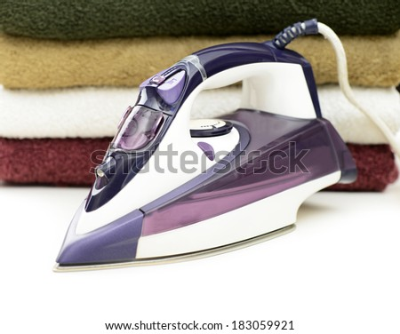 steam iron with cotton cloth - stock photo