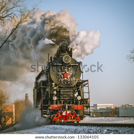 Steam Locomotive at the Kiev railway station in Moscow - stock photo