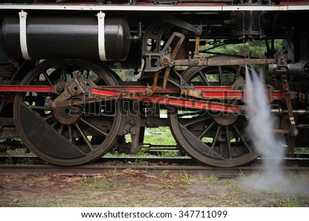 Steam locomotive detail with cranks and wheels - stock photo
