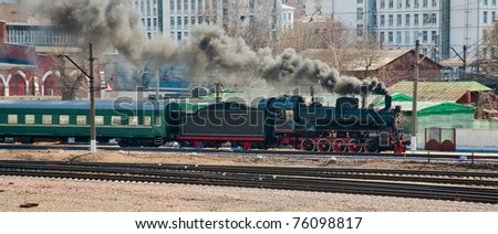 steam locomotive in city - stock photo