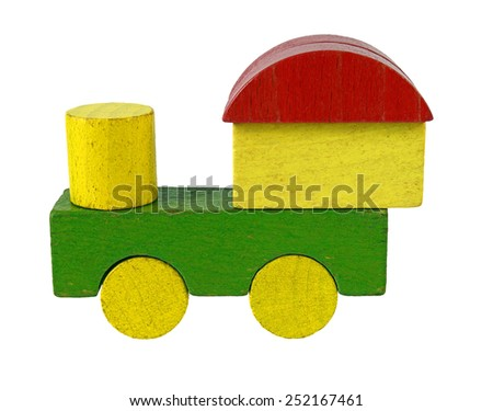 Steam locomotive of wooden blocks, traditional toy on white background - stock photo