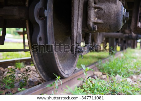 Steam locomotive rolling close up - stock photo