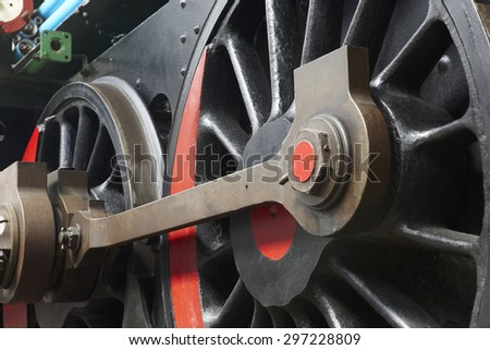 Steam locomotive wheel and connecting rod detail. Horizontal - stock photo