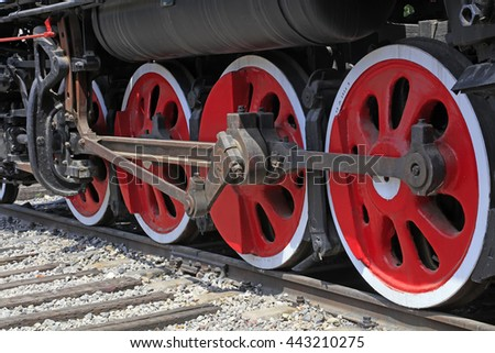 Steam locomotive wheel, closeup of photo - stock photo