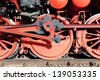 Steam locomotive wheels and rods - stock photo