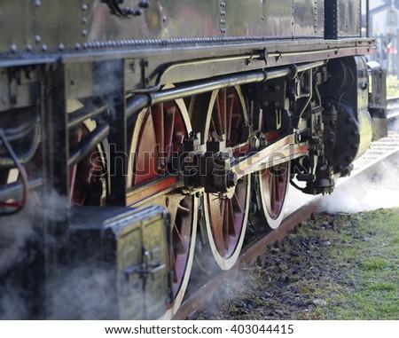 steam locomotive wheels close up in la speiza - stock photo