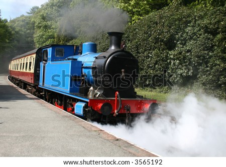 steam locomotive with steam and smoke