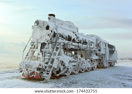 Steam machine on train station, covered with snow. Shore of Lake Baikal (Russia) - stock photo