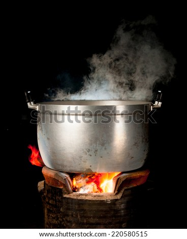 steam on pot in kitchen - stock photo