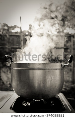 steam over cooking pot in kitchen  - stock photo