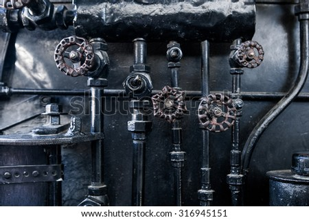 Steam punk black metal background. Background of engine room detail of a rare old steam locomotive - stock photo